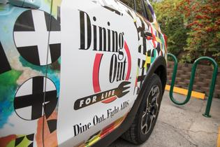 "Spokesperson Mondo Guerra designed a ""Pozitivity"" custom-wrapped vehicle (pictured) for Subaru and Dining Out For Life."