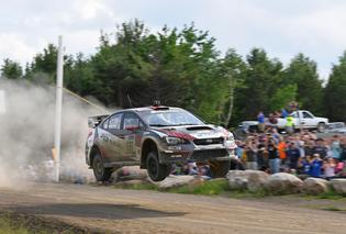 Subaru driver Travis Pastrana showed strong pace despite retiring early from the rally from an off.