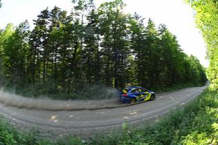 Solberg pushes flat out through a straight section of stage road on Friday afternoon at New England Forest Rally.