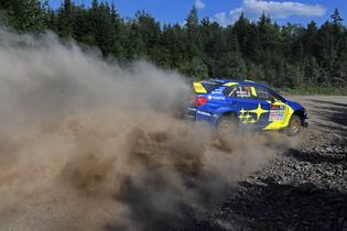 Oliver Solberg negotiates a fast right-hand corner in the New England forests.