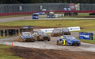 Rain before the event's semi-final rounds turned the track into slippery mud, favoring the rally-bred Subaru WRX STI rallycross cars and the World Rally Championship experience of Atkinson and Sandell.
