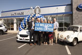 Subaru sells 10-millionth vehicle in the U.S. (L to R) Andrew Sidel (SOA), David Airington (SOA), Barry Jellick (SOA), Kirk Schneider (owner, Nate Wade Subaru), Rachel Harmon (customer), Marianne Harmon (customer), Jessica Tiedeken (SOA), Dr. Craig Harmon (new Impreza owner)