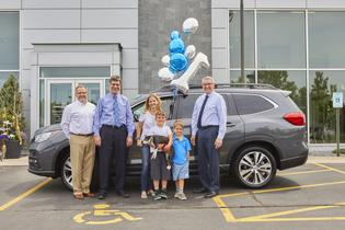 Subaru sells first 3-row Ascent SUV, (L to R) Mark Schreiber, Don Sommer, Samantha Ernest, Caiden Henderson, Brewer the dog, Oliver Henderson, and Wally Sommer