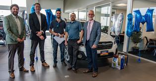 Subaru sells two-millionth Outback in the U.S.(L to R) Sean Sullivan (president, Subaru Pacific) Andrew Simpson (Outback owner), Tim Tagye (Subaru of America), James Miller (sales consultant, Subaru Pacific) and Frank Ceccacci (Subaru of America)