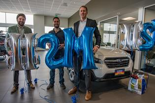 Subaru sells two-millionth Outback in the U.S. (L to R) Sean Sullivan (president, Subaru Pacific) Andrew Simpson (Outback owner), and Tim Tagye (Subaru of America)
