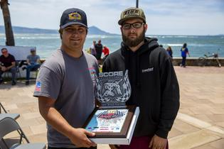 Grabowski Brothers Racing shows off the Class 5 champion's trophy after the Baja 500.