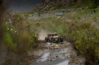 The Crosstrek Desert Racer enters a muddy section of the Baja 500 course.