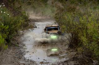 The Crosstrek Desert Racer splashes through water and mud during the Baja 500.