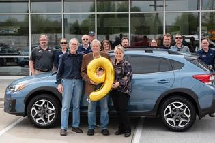 Subaru of America, Inc. sells nine-millionth vehicle (L to R in foreground): Dr. Hershey Garner (new Crosstrek owner), Don Nelms (owner, Adventure Subaru) Denise Garner (new Crosstrek owner)