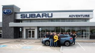 ubaru of America, Inc. sells nine-millionth vehicle (L to R in foreground): Dr. Hershey Garner (new Crosstrek owner), Don Nelms (owner, Adventure Subaru) Denise Garner (new Crosstrek owner)Don Nelms (owner, Adventure Subaru) Denise Garner (new Crosstrek owner)