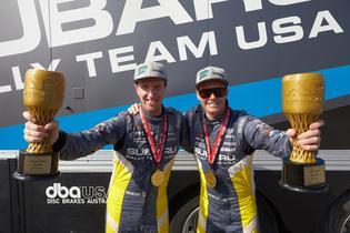 Codriver Per Almkvist and driver Patrik Sandell celebrate Olympus Rally victory