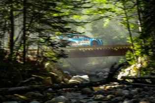 The #75 Subaru WRX STI of David Higgins and Craig Drew blasts across a bridge en route to a win at New England Forest RallyPhoto credit: Matthew Stryker