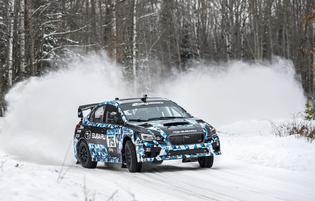 Defending Rally America champ David Higgins delivered a flawless run of Sno*Drift rally to win the event.