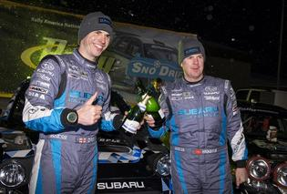 David Higgins and Craig Drew of Subaru Rally Team USA claim victory at Sno*Drift Rally.