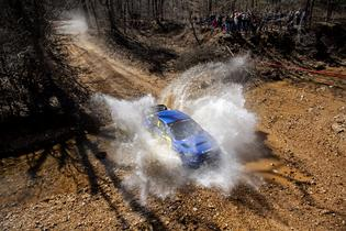 David Higgins splashes through one of several water crossings at the Rally in the 100 Acre Wood. Photo credit: Ben Haulenbeek / Subaru Motorsports USA
