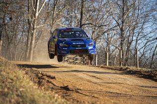 David Higgins and co-driver Craig Drew go airborne over the famous cattle guard jump at the Rally in the 100 Acre Wood. Photo credit: Ben Haulenbeek / Subaru Motorsports USA
