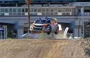 Bucky Lasek charging hard over the jump in his 600 horsepower WRX STI.