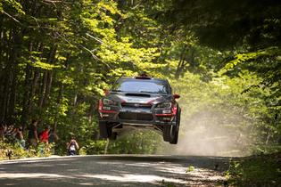 Travis Pastrana catches air at NEFR. Photo Credit: Lars Gange / Subaru Rally Team USA