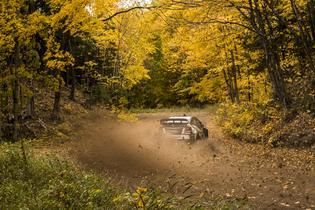 Travis Pastrana rockets his Subaru through the scenic-Upper Peninsula of Michigan