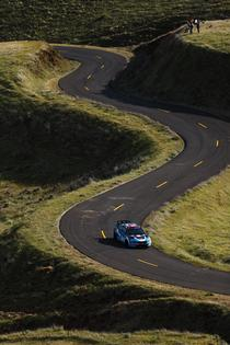 David Higgins and co-driver Craig Drew race down the serpentine like Maryhill Loops Road at the Oregon Trail Rally. Credit: Louis Yio / Subaru Rally Team USA
