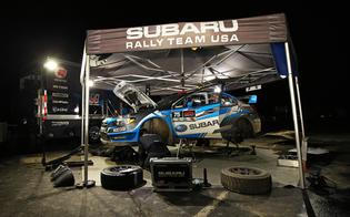 The Subaru Rally Team USA technicians performing service on the #75 Subaru WRX STIPhoto Credit: Matthew Stryker / Subaru Rally Team USA
