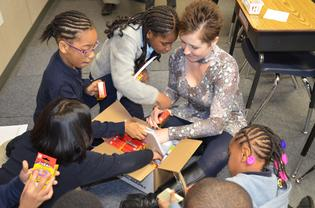 Cream third grade students and their teacher Mrs. Moore check out new school supplies 01
