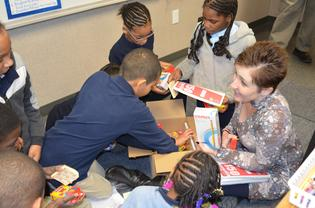 Cream third graders and their teacher Mrs. Moore unpack their new school supplies 2