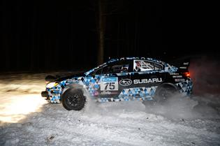 Subaru Rally Team USA's first 2015 WRX STI rally car ploughs through the snowy roads of Michigan at Sno*Drift Rally.
