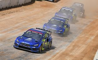 Andreas Bakkerud, Chris Atkinson and Joni Wiman charge through the dust into COTA's tight hairpin corner.