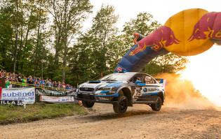David Higgins and Craig Drew take flight at the spectator point at the Ojibwe Forest Rally