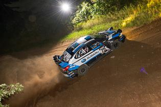 David Higgins and codriver Craig Drew lept into the lead of the Ojibwe Forest Rally after winning all three night stages held Friday