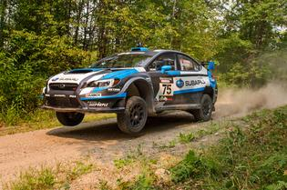 David Higgins and codriver Craig Drew lift off in their 2015 Subaru WRX STI at the Ojibwe Forest Rally