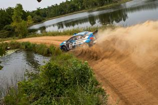 David Higgins and codriver Craig Drew sliding between lakes in northern Minnesota at the Ojibwe Forest Rally