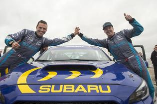 David Higgins and Craig Drew celebrate a strong result at Wales Rally GB.