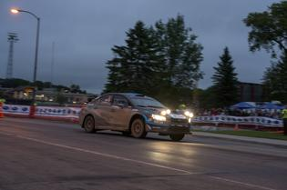 David Higgins and codriver Craig Drew attack the Subaru Street Stage in downtown Detroit Lakes MN