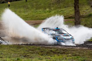 David Higgins blasts through a water splash at the Oregon Trail Rally.
