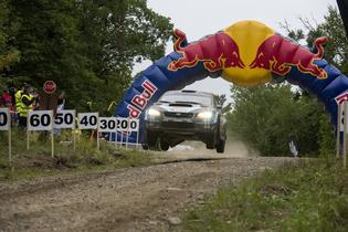 David Higgins jumps his Subaru at the Ojibwe Forests Rally