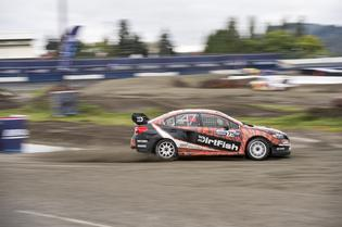 David Higgins locks the rear wheels to initiate a slide through the mud at GRC Seattle