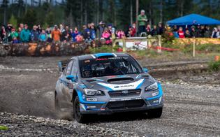 David Higgins passes a spectator point at the Olympus Rally.
