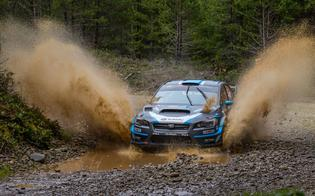 David Higgins powers through standing water on the course at the Olympus Rally.