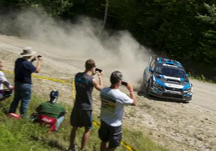 David Higgins slides by rally fans at New England Forest Rally 2016