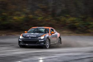 A student controlling the rear-wheel drive DirtFish Subaru BRZ in wet, slippery conditions.