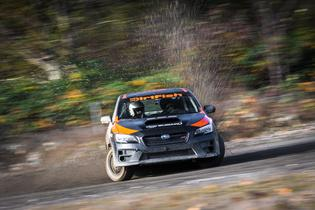 A student countersteering through a righthand corner in one of the DirtFish Subaru WRX STI School Cars.