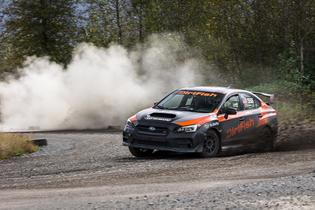 A DirtFish instructor giving the student a demonstration lap in a Subaru WRX STI School Car.