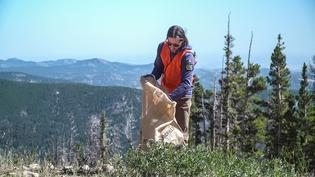 A Subaru volunteer joins the effort to collect scrap metal, recycled plastic, landfill waste and other trash from Eldora Mountain on National CleanUp Day, September 21, 2019.
