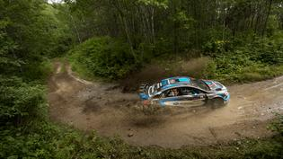 Higgins and Drew slide through the mud at the Ojibwe Forests Rally