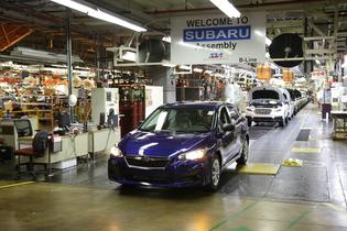 The first American-built 2017 Subaru Impreza rolls off the assembly line at Subaru of Indiana Automotive (SIA) plant in celebration event.