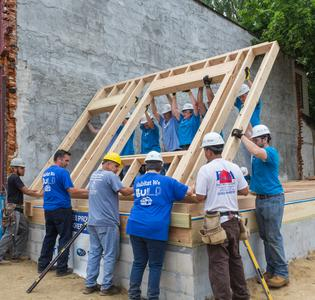 Subaru of America and Habitat for Humanity volunteers erect a wall for a deserving Camden family on June 16, 2017.