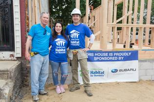 Tom Doll, President and COO for Subaru of America (left), and Jeff Mihalek, Executive Director for Camden County Habitat for Humanity (right), take a break to meet with Jessica Martinez of the deserving family receiving the Camden County Habitat For Humanity home.