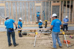 Subaru of America volunteers construct materials for a new Camden County Habitat for Humanity home on June 16, 2017